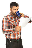Man drink coffee and holding paper Royalty Free Stock Images