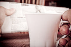 Man drink coffee and reading newspapers Stock Photo
