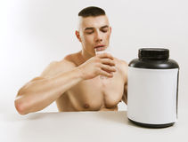 Man drink protein shake. Athletic young man with protein shake royalty free stock photography