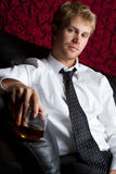Man Drinking Alcohol. Young man drinking scotch alcohol Royalty Free Stock Photo