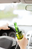 Man drinking alcohol while driving the car Royalty Free Stock Image
