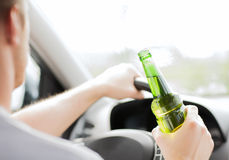 Man drinking alcohol while driving the car Royalty Free Stock Images