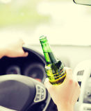 Man drinking alcohol while driving the car Stock Photo