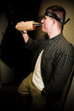 Man Drinking Alcohol in Urban Setting Royalty Free Stock Photos