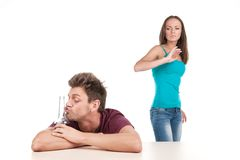 Man drinking alcohol and woman leaving him. Stock Image