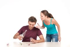 Man drinking alcohol and woman shouting at him. Royalty Free Stock Photo