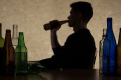 Man is drinking alcohol. Young man is drinking too much alcohol Stock Photo