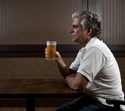 Man drinking alone. In a bar stock image