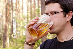 Man is drinking beer stock photos