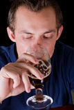 Man drinking a beer Stock Images
