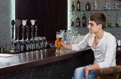 Man drinking beer alone on a pub Stock Images
