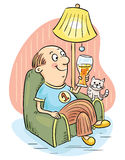 Man drinking beer in an arm-chair Stock Images