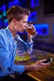 Man drinking beer at bar counter Royalty Free Stock Image