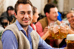 Man drinking beer in Bavarian pub Stock Photo