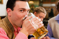 Man drinking beer in Bavarian pub Stock Photography