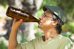 Man drinking beer from bottle Stock Image