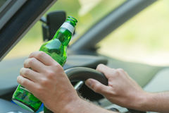 Man drinking beer in a car Stock Photos