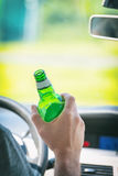 Man drinking beer while driving a car Royalty Free Stock Photography