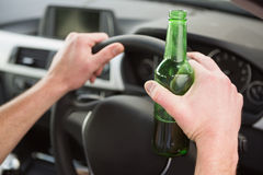 Man drinking beer while driving Royalty Free Stock Photos