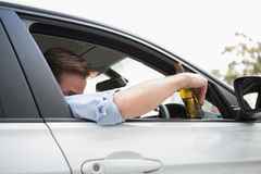 Man drinking beer while driving Royalty Free Stock Photography