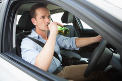 Man drinking beer while driving Royalty Free Stock Photo