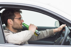 Man drinking beer while driving Stock Photos