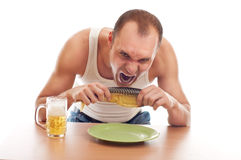 Man drinking beer and eatin fish Stock Photo