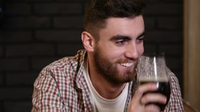 Man drinking beer and enjoying beverage at pub bar HD close-up slow-motion video. Male guest tastes lager from glasses. Man drinking beer and enjoying beverage stock video