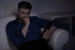 Man drinking beer at home Stock Image