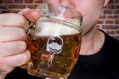 Man is drinking beer in a pub Stock Image