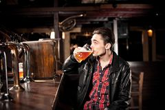 Man drinking beer in pub Royalty Free Stock Images