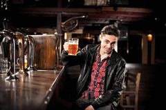 Man drinking beer in pub Royalty Free Stock Photo
