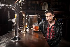 Man drinking beer in pub Stock Images