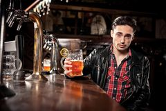 Man drinking beer in pub Royalty Free Stock Photography