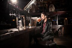 Man drinking beer in pub Stock Photography