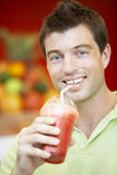 Man Drinking A Berry Smoothie royalty free stock photography