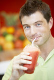 Man Drinking A Berry Smoothie Royalty Free Stock Photos