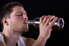 Man drinking from the bottle Stock Images