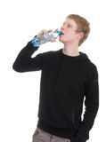 Man drinking bottled water Royalty Free Stock Images