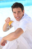 Man drinking cocktail Stock Photography