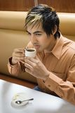 Man drinking coffee. Royalty Free Stock Images