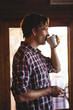 Man drinking coffee alone Royalty Free Stock Images