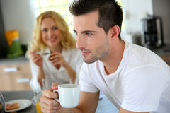Man drinking coffee for breakfast Royalty Free Stock Image