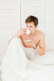 Man drinking coffee at Breakfast in bed Royalty Free Stock Photography