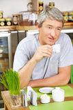 Man drinking coffee in café Stock Photos