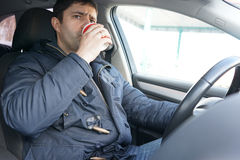 Man drinking coffee in the car Stock Photography