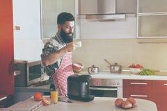 Man drinking coffee with coffee machine Stock Image