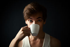 Man drinking coffee on dark  background Royalty Free Stock Images