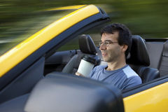 Man drinking coffee while driving Stock Photo