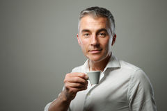 Man drinking a coffee Royalty Free Stock Image